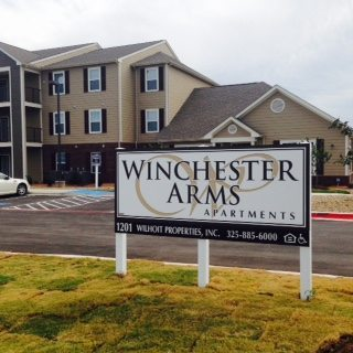 AWinchester-Arms-Comanche-Texas-Sign-with-building