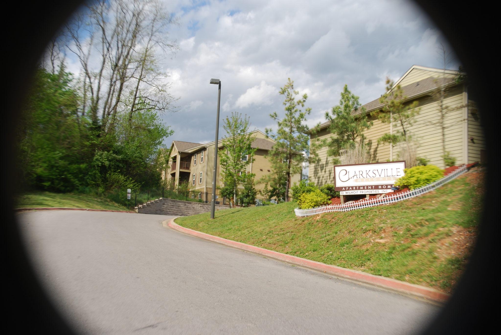Clarksville-Heights-Clarksville-TN-sign-w-building-in-background