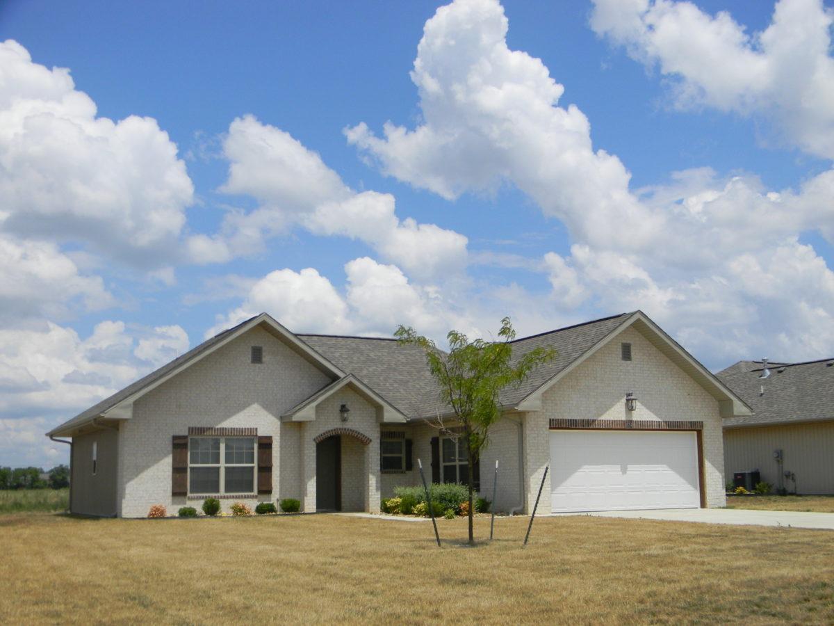 Oaklawn-Estates-Rogersville-Missouri-Tan-Brick-Home-sunny-day