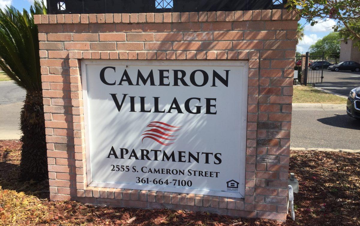 Cameron Village Apts Alice TX sign sunny