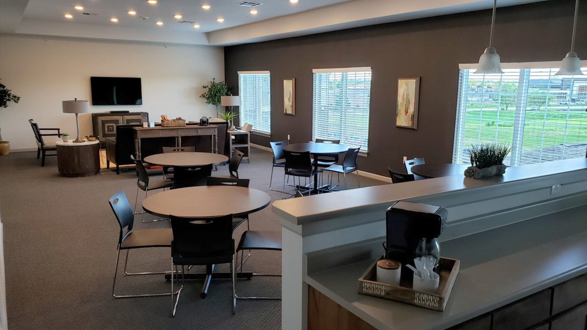 Villas at Lark Pointe community game and kitchen room